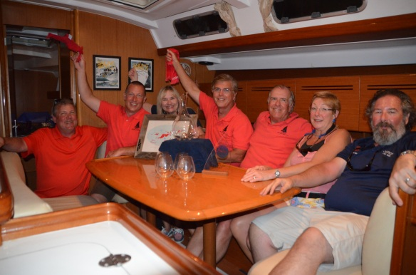 Dan and Larry waving the Red Towel while celebrating the win onboard Mary Jewell.